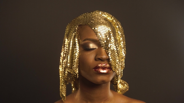 Download Fashion Portrait Of Glossy African American Woman With Bright Golden Makeup. Bronze Bodypaint, Black nulled download
