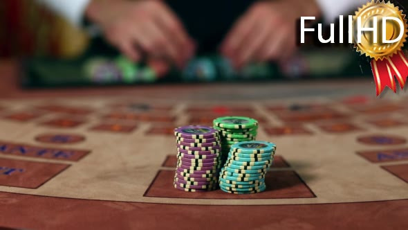 Download Croupier Moves Chips on Table at Casino nulled download