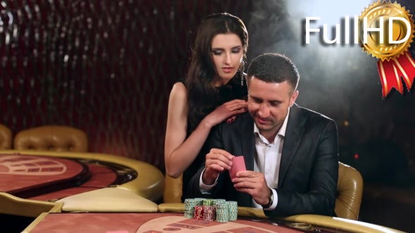 Download Pair Placing Their Bets on the Blackjack Table nulled download