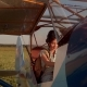 Girl Driving An Old Airplane