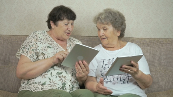 Download Two Elderly Women Holding The Digital Tablets nulled download