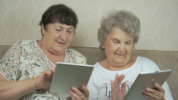 Download Old Women Holding The Silver Digital Tablets nulled download