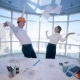Business People Celebrates Their Success And Throws Papers Up Into The Air In Bright Clean Office