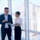 Business, Architecture And Office Concept. Two Successful Businessmen Discuss Project On Tablet In