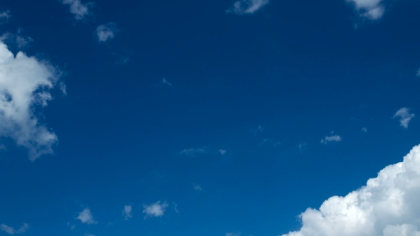 Download  Clip Of White Fluffy Clouds Over Blue Sky. Beautiful Cloudscape nulled download