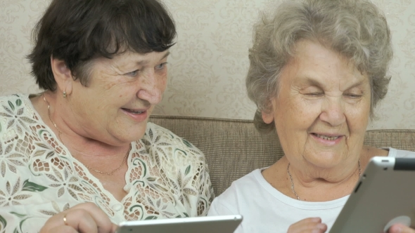 Download Two Elderly Sisters Holding Silver Digital Tablets nulled download