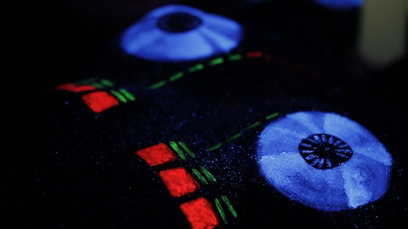 VideoHive The Artist Draws a Fluorescent Powder On The Body Of a Naked Girl DJ Mixer 17514172