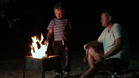 Download Family Have a Rest In Camp At Night Near Campfire nulled download