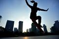 Skateboarder skateboarding at sunrise city