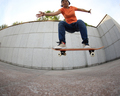 young woman skateboarder practice outdoor
