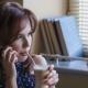 Beautiful Young Girl Drinks Coffee
