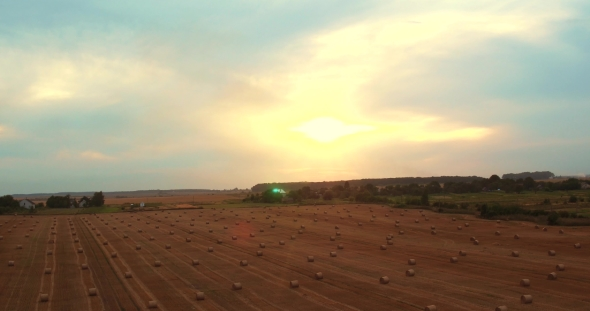 Download Aerial Field With Straw Bales Under Sunset Sky nulled download