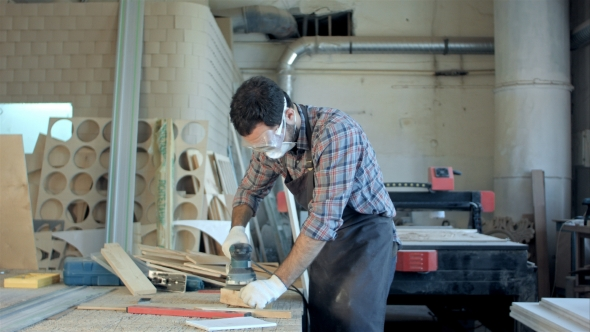 Download Bearded Carpenter In Safety Glasses Working With Electric Planer In Workshop nulled download