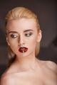 Closeup portrait of a young blonde woman bright makeup