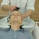 Handsome Man Having His Hair Washed In Hairdressing Saloon
