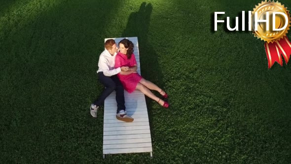 Download Aerial Slow Motion Video of Couple Lying on the nulled download