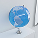 Clear blue Earth globe on chrome stand