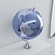 Metallic blue Earth globe on chrome stand