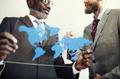 Businessmen World Map Glass Concept
