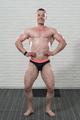 Bodybuilder Fitness Model Flexing Muscles