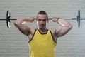 Man Exercising Triceps On White Bricks Background