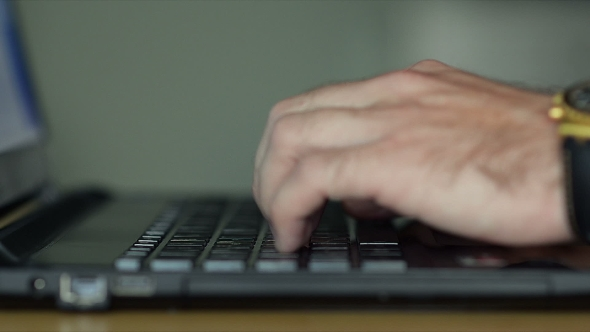 Download Male Hands Typing On a Laptop Keyboard At Home nulled download