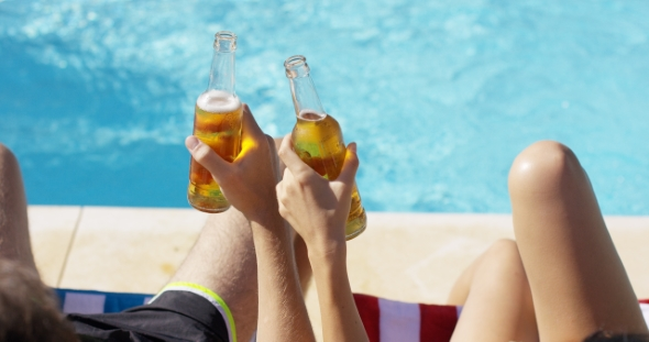Download Couple Relaxing At The Pool With Beers nulled download