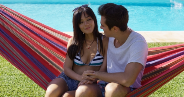 Download Loving Young Couple Sitting On a Hammock nulled download