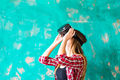 Woman in virtual reality headset enjoying her experience