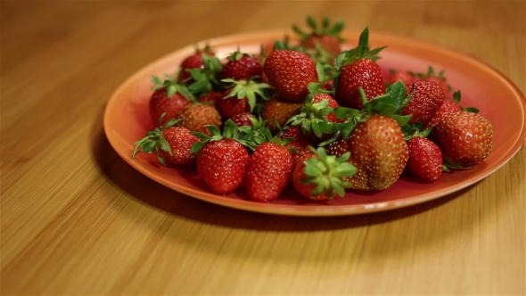 Download Taking a Strawberry From Plate nulled download