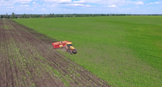 Agriculture seeder and tractor work on the field aerials and dolly shots