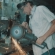 Senior Man Working With Angle Grinder