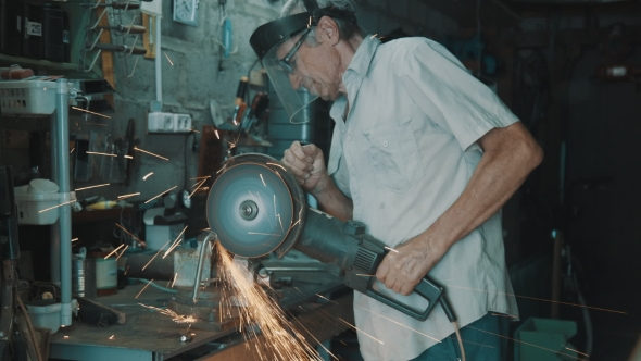 Download Senior Man Working With Angle Grinder nulled download