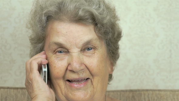 Download Grandmother Having a Call On Mobile Phone Indoors nulled download