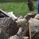 Blurred Farmer Man Chop Wood With Axe.