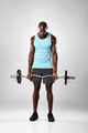 Young african man working out with barbell