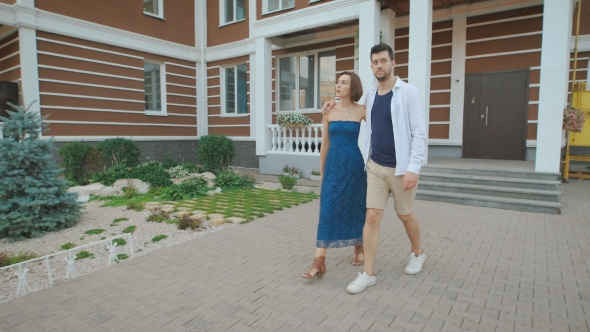 Download Young Family Leaves The Entrance Of Their New Home. nulled download