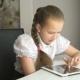 Primary Schoolgirl Using a Digital Tablet Computer