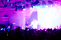 Blurred Stage Performance in Purple Light