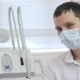 A Young Male Dentist, Disposable Mask, Next To Dental Instrument, Looking Right.
