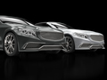 Metallic modern cars on black reflective background