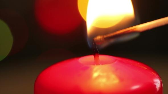 Christmas Candle Lit Match.