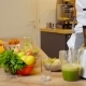 Green Smoothie Woman Making Vegetable Smoothies With Blender.