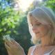 Beautiful Girl Using SmartPhone Enjoying the Sun in City Park 3