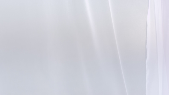Sheer white curtains blowing in the wind by flatbox videohive