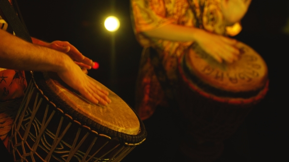 Download The Drummers Beat a Hand Drum nulled download