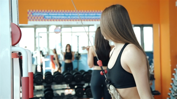 Download Young Strong Girl Do Exercises On Cable Crossover Machine.20s nulled download