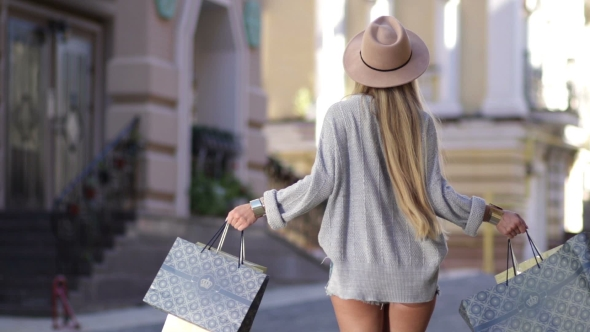 Download Lovely Woman With Shopping Bags Spinning Around nulled download