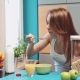 Woman Eating Healthy Breakfast Cereals With Milk And Drinking Orange Juice