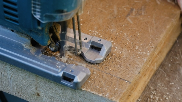 Download Man Sawing Plank Electric Fretsaw  nulled download